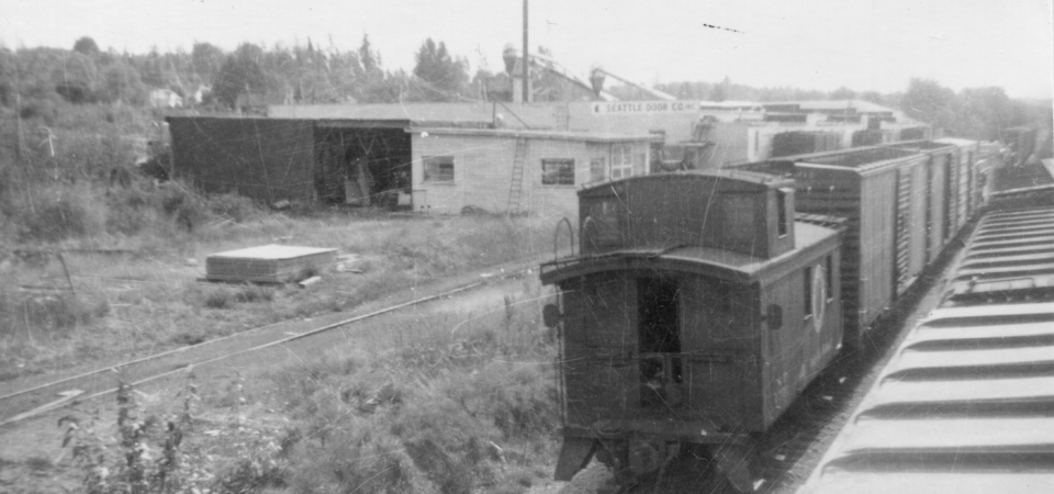 Feriton-Seattle-Door-Co.-looking-S-with-Train-676-1957-John-Magnuson